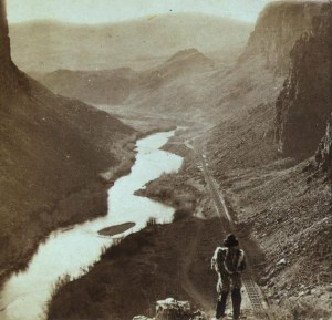 Native American overlooking the newly completed transcontinental railroad in 1868